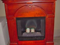 This is a gorgeous fireplace!! It heats from gel ( you