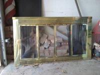 I have a brass fireplace cover with glass panels and