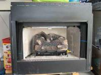 fire place insert, gas, logs, works great puts off a