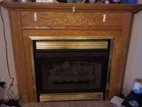 24 inch propane gas log insert with corner oak mantel