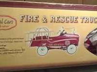 Brand New in the Box!! Kids red pedal fire truck. Metal