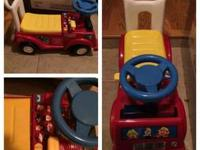 Fire truck emergency push and ride on toy. My son just