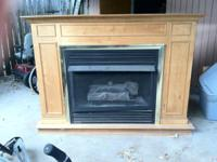Custom built fireplace with gas logs and blower fan.
