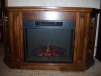 fireplace with mantel on top of fireplace. all oak wood