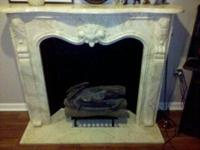 this is a white marble fire place mantle that is in