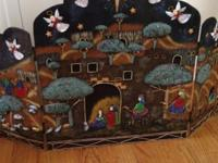 This fireplace screen with nativity scene. Just a year