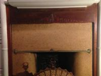 Intricately decorated, ceramic fireplace screen with