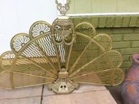Lovely brass with fan out style screen. Great for