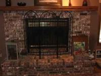 Fireplace screen. Black metal. Holds 18 glass cups for