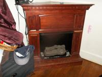 Wood corner fireplace that runs on Steno. A few