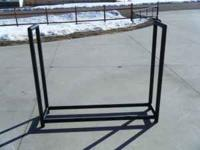 "Firewood rack, made of 2"" steel pipe. call/text"