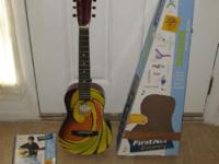Available is a First Act Designer Acoustic Guitar. It