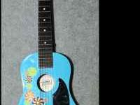 Works fine. No broken strings. Comes with strap. Has