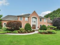 First time offered! This exceptional Brick Colonial