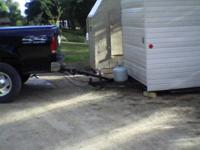6 X 12 fish house with retractable wheels. Also has