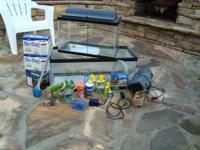 10 gallon and 20 gallon fish tanks with various items