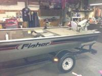 2002 16.5 feet Fisher bass boat,wide comfortable,new