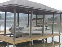 2001 Fisher Freedom 2210 aluminum deck boat with a