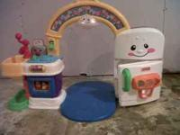 Fisher price laugh n learn 2 in 1 learning kitchen, in