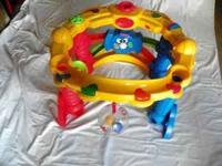 This Fisher Price Activity Center keeps an infant/small