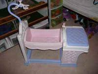 Baby doll crib & wash station underneath the purple