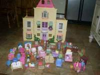For sale is a FISHER PRICE DOLL HOUSE and a large lot