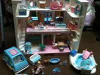 This is a fisher price little house with lots of acc.