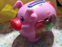 Includes 7 colorful animal coins. Introduces baby to