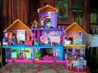 I think this is a Fisher Price castle home doll house.