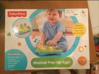 New in Box, Fisher Price Musical Pop-Up Eggs. I had