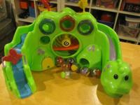 This is a Fisher-Price Roll-a-Rounds Drop & Roar