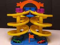 FISHER PRICE TURN-N-BURN SPIRAL RACE TRACK We have a
