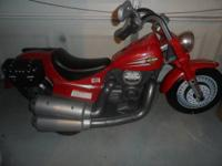 This is a kids Harley Davidson Fisher Price Power