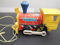 This is a 1964 Fisher-Price Toot-Toot train engine in