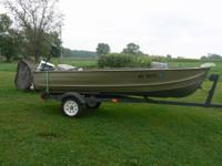 14 foot fishing boat with trailer. this boat has a 15