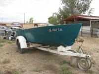 Vintage wood & fiberglass boat & trailer.  Good