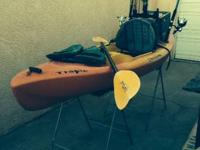 10' kayak set up for fishing. It has two pole holders