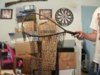 I have a small fishing net, dark brown, 2ft tall 1 ft
