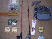Two fishing poles with reels, some hooks, lures, tackle