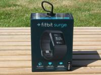 Used and in excellent condition Fitbit Surge in size