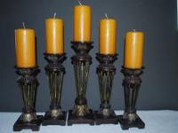 Here are five candle holders (made of metal and resin)