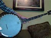 Very nice fender Banjo with a soft case. This was