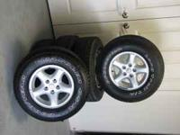 Five 'almost new' tires mounted on stock aluminum