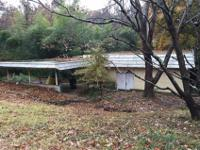 I've got a lead on a fixer upper near Brookhaven that
