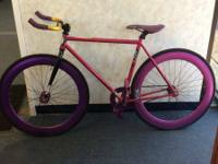 We have a beautiful pink and purple fixie. The bike is