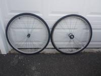 A pair of 700c wheels with flip flop hubs for a fixed