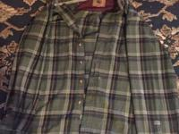 Here I have a slightly used Green flannel size Xl, fits