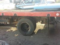 "USED FLAT BED 94"" X 114""   HAS WOOD FLOOR WITH HOIST"