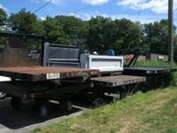22 ft STEEL DECK flat bed . . . $ 2,200.00 14 ft rack