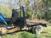 A very nice heavy flat bed with torch bottle rack and